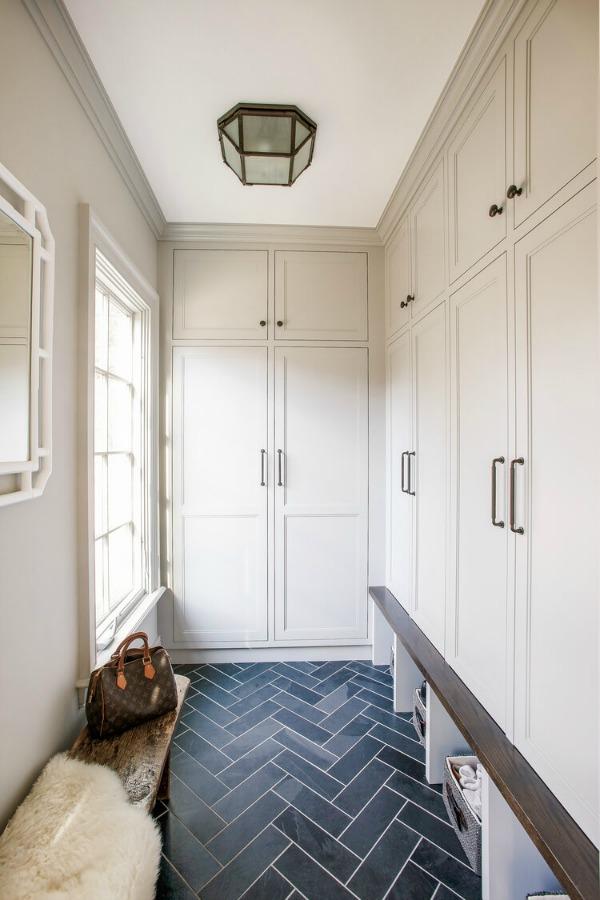 Stunning mudroom with built-ins, custom millwork, and bold blue herringbone tile floor - Edward Deegan Architects. #mudroom #builtins #blueandwhite #interiordesign