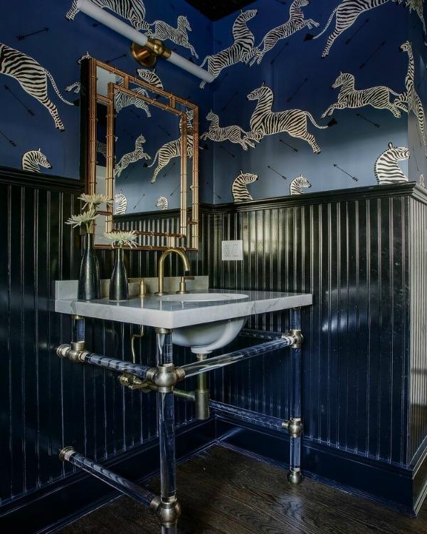 Stunning bathroom design with bold blue zebra wall covering, console sink, and gold hardware - Edward Deegan Architects. #powderbath #bathroomdesign #bluebathroom #interiordesign