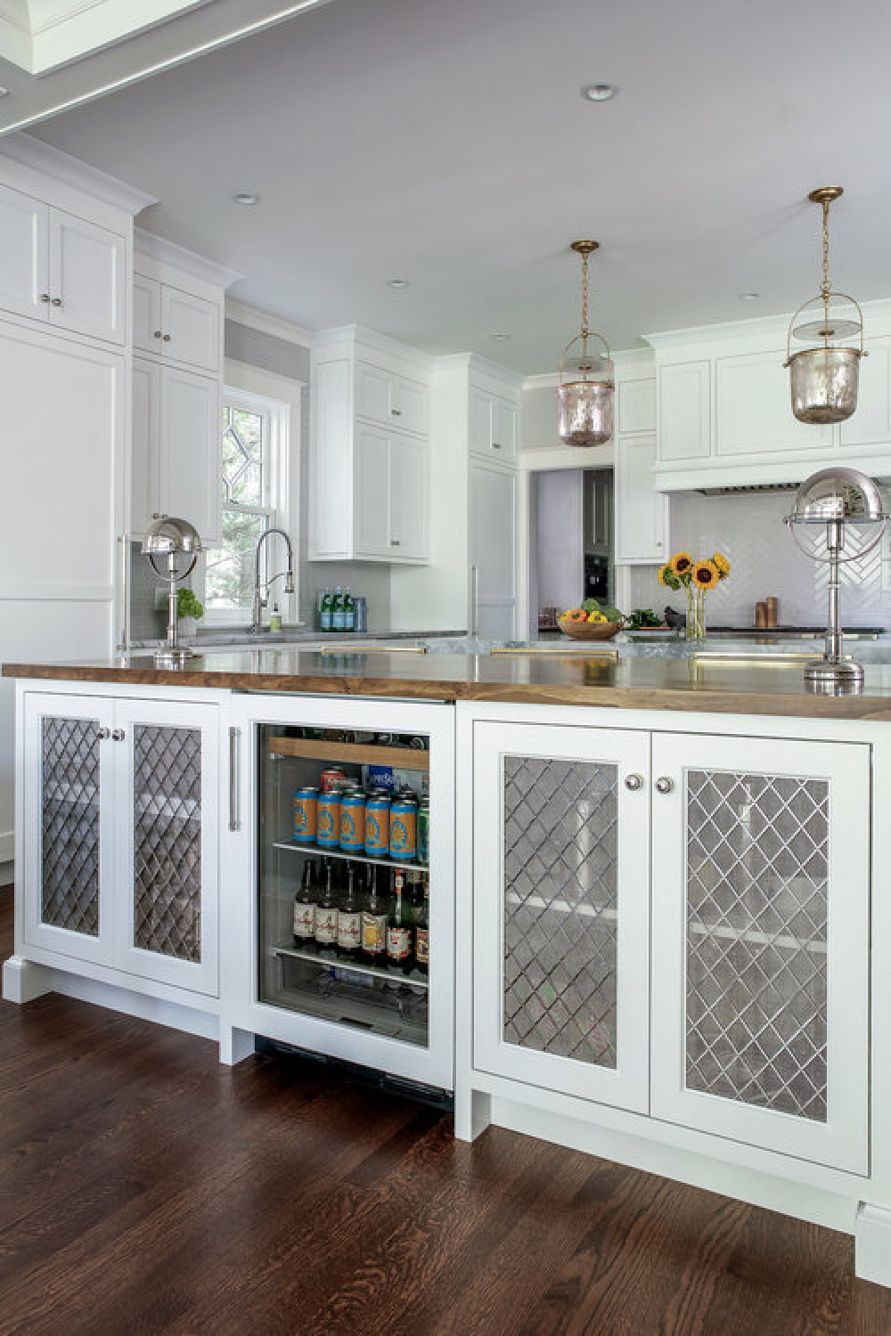 Beautiful classic style in a classic kitchen by Edward Deegan with white Shaker cabinets.
