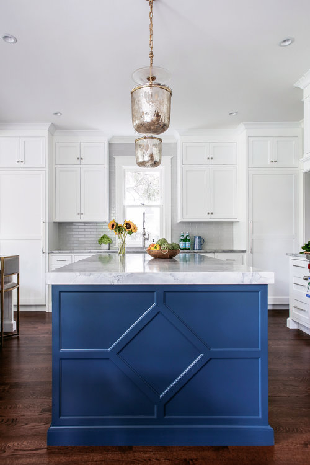Classic blue painted island in a traditional style white kitchen by Edward Deegan Architects.