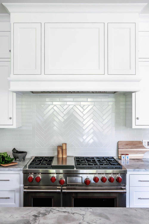 Classic white kitchen with professional stainless range and white tiled backsplash - Edward Deegan Architects.