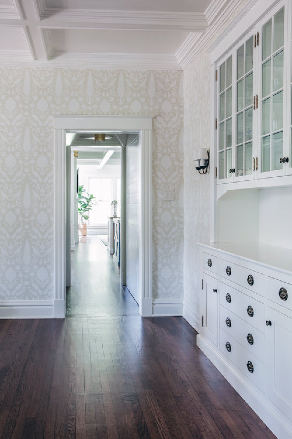 Beautiful muted traditional style wallpaper in a dining room with classic builtins - Edward Deegan Architects.