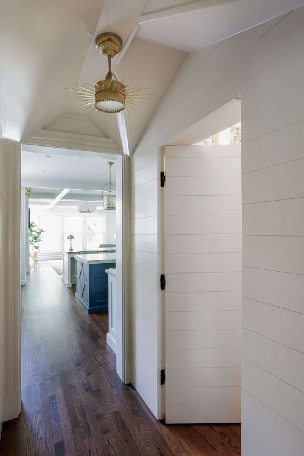 Classic style in a hallway with white shiplap and custom millwork by Edward Deegan Architects.