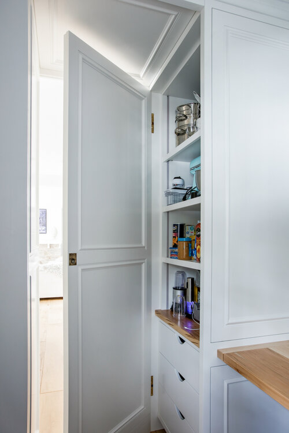 Detail of interior of a pantry in a classic white kitchen by Edward Deegan Architects. Find more blue kitchen ideas in this story!