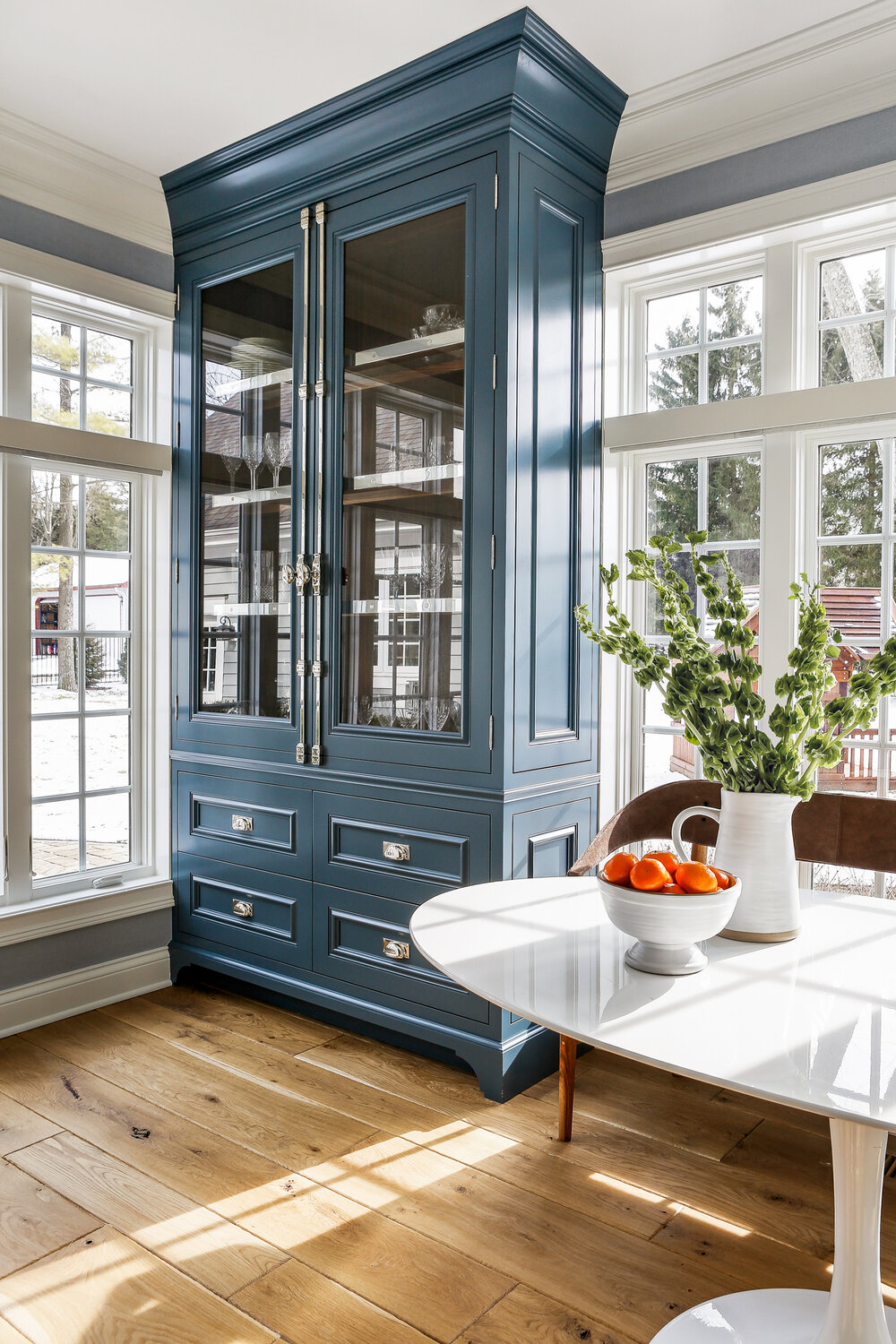 Beautiful blue tall cupboard and hutch with glass doors in a breakfast nook with traditional classic design by Edward Deegan Architects. Find more blue kitchen ideas in this story! #breakfastnook #bluecupboard #bluekitvhen