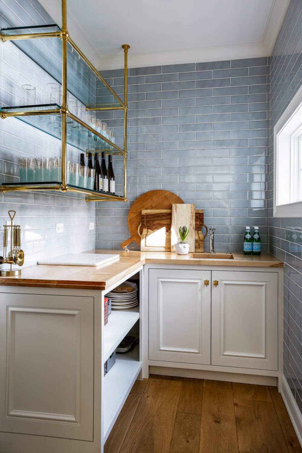Beautiful blue kitchen ideas - tiled wall in a butler pantry with open shelving and wood counters - design by Edward Deegan Architects. #butlerpantry #bluetile #bluebacksplash