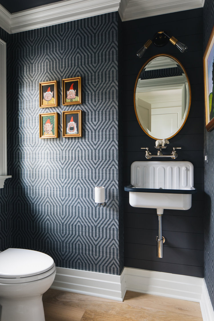Dramatic and whimsical, a black and white modern farmhouse powder bath in a magnificent home by Edward Deegan Architects sings! Notice the charming farm sink! #bathroomdesign #modernfarmhouse #blackandwhite #powderbath