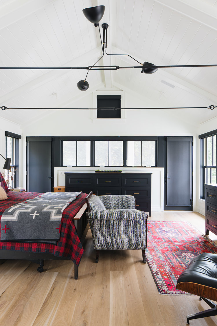 Richly dramatic, this modern farmhouse bedroom with black and white has exceptional architectural interest, imagined by Edward Deegan. #modernfarmhouse #blackandwhite #bedroomdesign #interiordesign