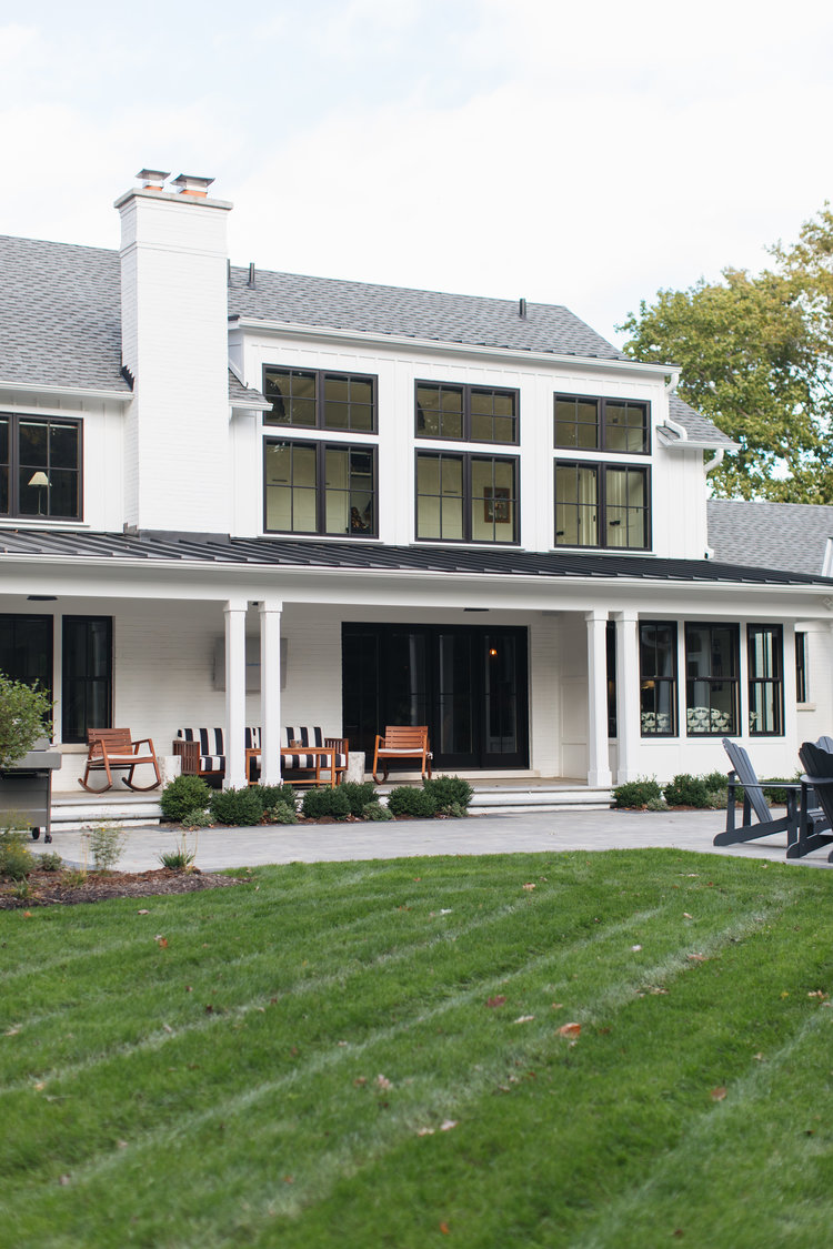 White and black modern farmhouse exterior with black doors and black windows - Edward Deegan Architects. #modernfarmhouse #blackandwhite #houseexteriors #housedesign