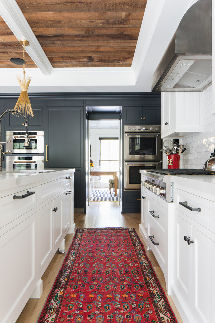 Timeless, traditional, and classic, this black and white modern farmhouse kitchen by Edward Deegan feels approachable yet luxurious. #modernfarmhouse #interiordesign #blackandwhite #kitchendesign