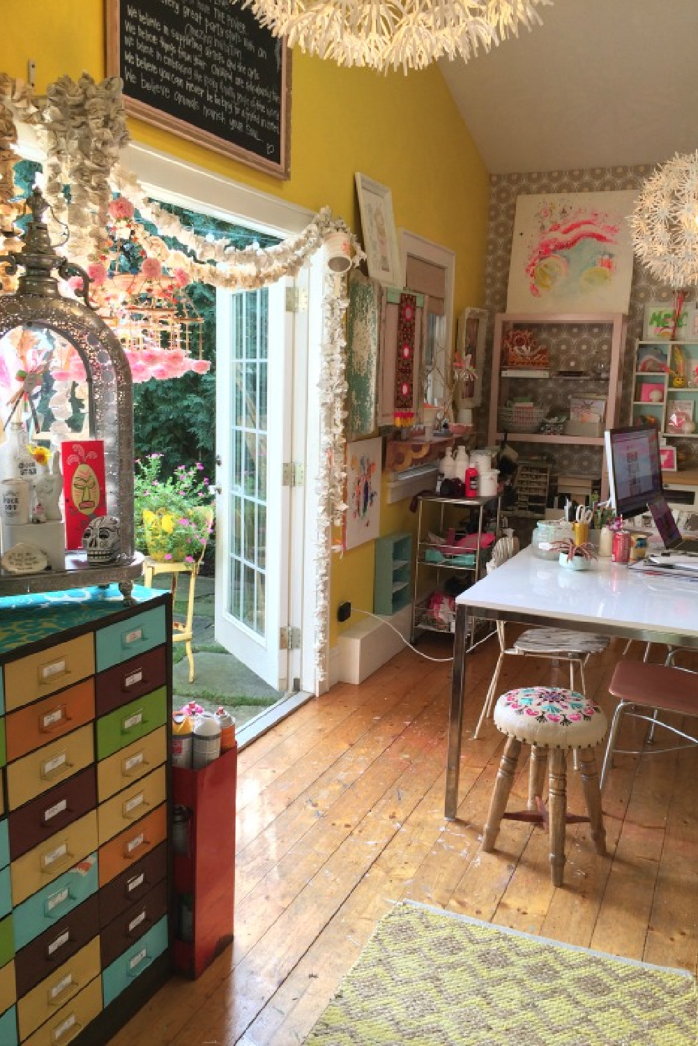 Cheerful and colorful art studio of Jenny Sweeney with flea market style and wild whimsy.