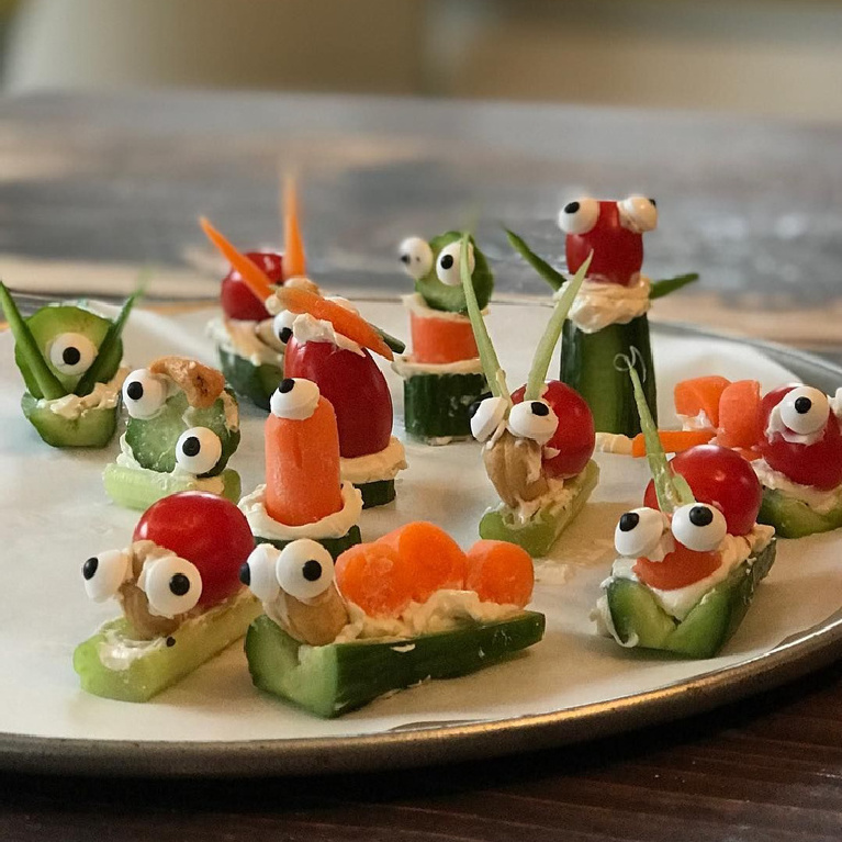 Whimsical vege appetizers with googlie eyes resembling the art of Jenny Sweeney.