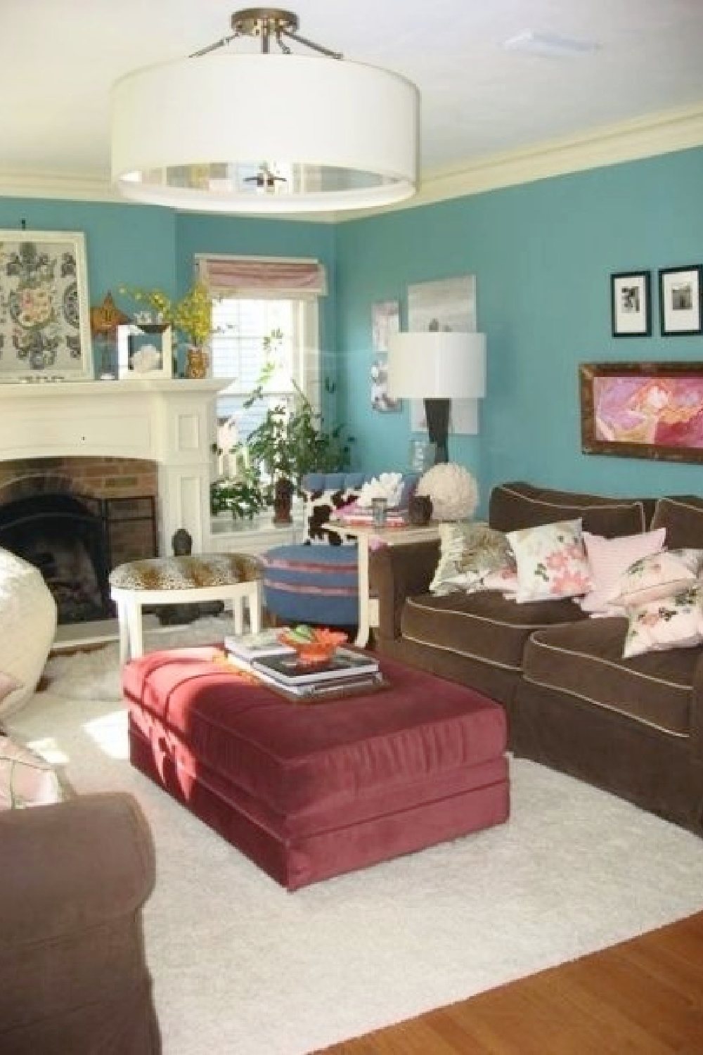 Turquoise walls and flea market beachy boho style in Jenny Sweeney's living room in a suburban Tudor home.