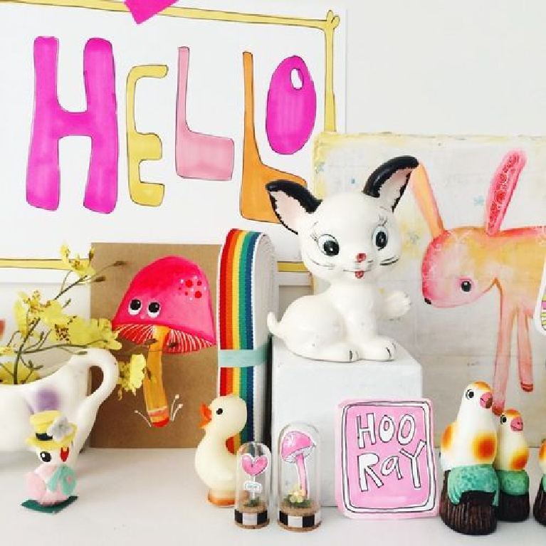 Darling vintage knick knacks and happy color converge in a whimsical vignette by artist Jenny Sweeney.