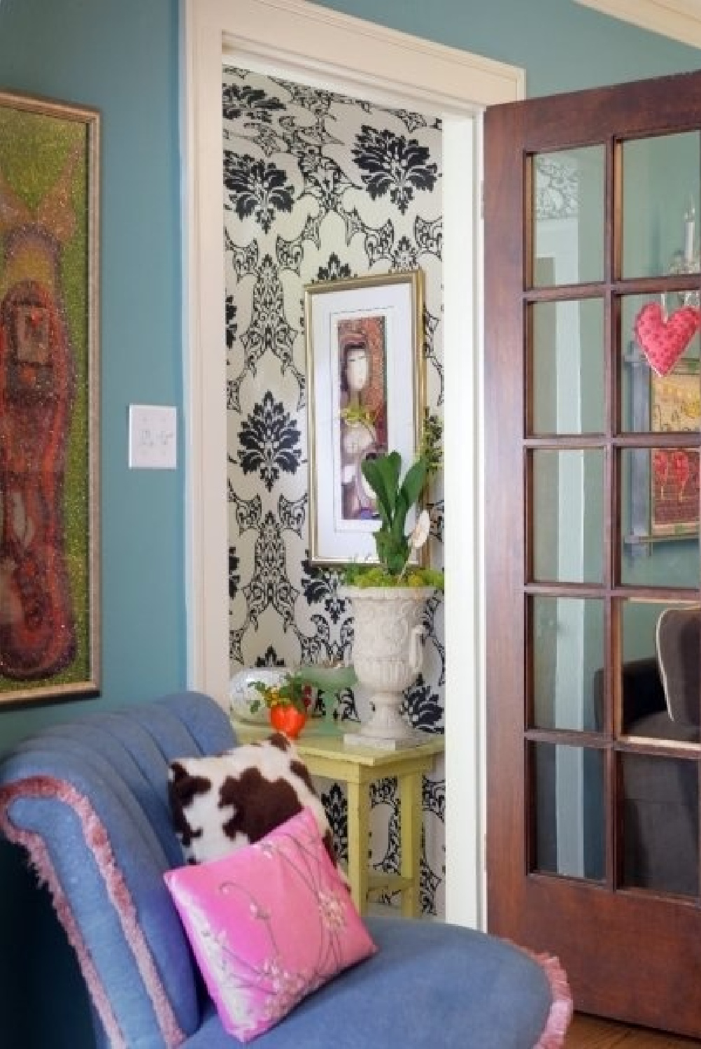 Turquoise wall in a groovy foyer with eclectic flea market style - Jenny Sweeney.