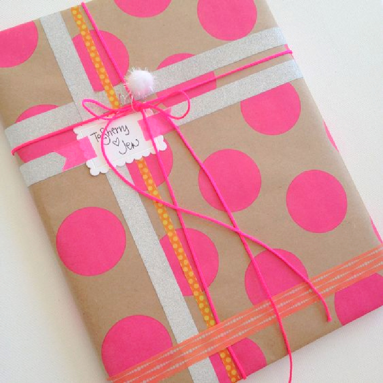 Whimsical gift wrap with washi tape and hot pink dots and kraft paper - Jenny Sweeney.