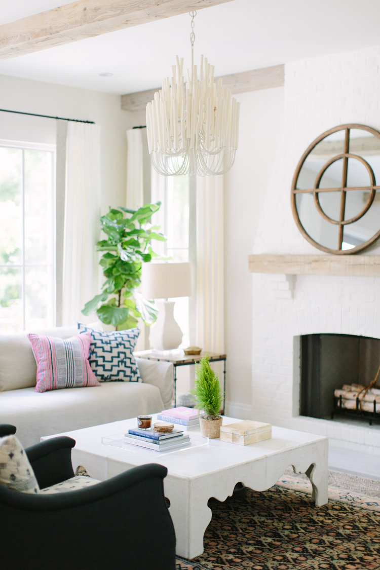Beautiful and simple white fireplace in a modern farmhouse living room with design by Kate Marker in Barrington, IL. Come enjoy encouraging love quotes and timeless decor inspiration! #modernfarmhouse #livingroom #fireplace