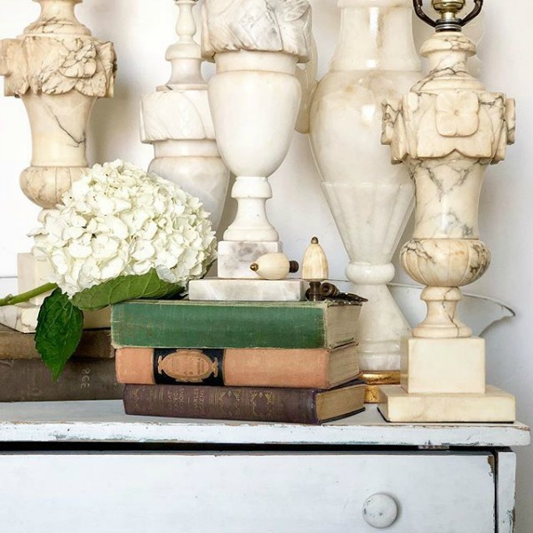 White vintage alabaster marble lamps grouped together in a rustic vignette by Le Cultivateur. #whitedecor #countrystyle #countrydecor #toneontone