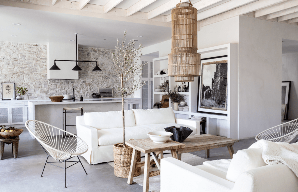 Leanne Ford's rustic warm minimal white great room for HGTV's Rock the Block. #leanneford #modernrustic #interiordesign #warmminimal #roughluxe #vintageboho