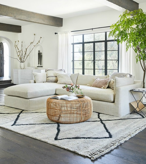 Stunning warm white contemporary living room with sectional and neutral decor - Lulu & Georgia. #livingroom #modernfarmhouse