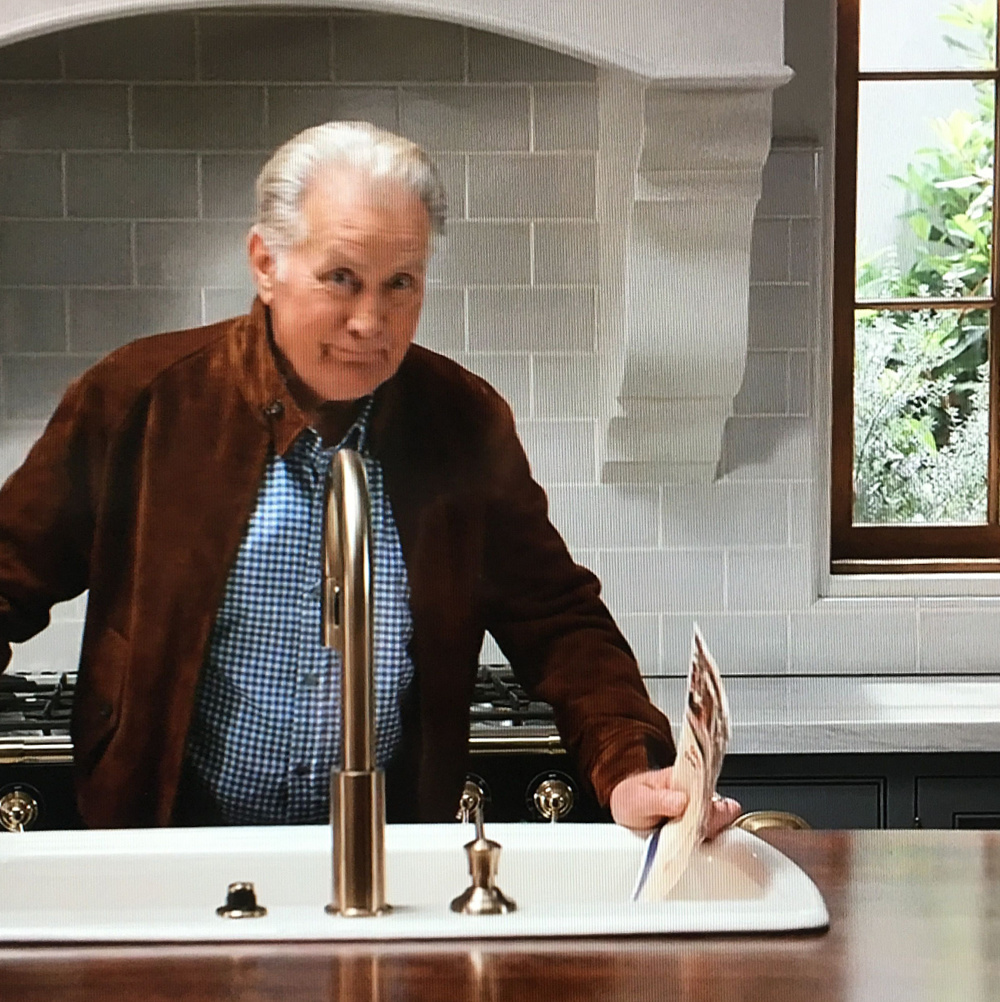 Robert and Sol kitchen from the set of GRACE & FRANKIE - a gorgeous eclectic design with Spanish tile, a French range, and a mix of marble and wood finishes. #graceandfrankie #robertandsol #interiordesign #setdesign