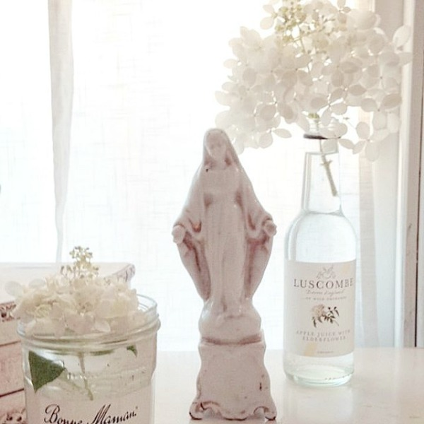 Gentle white on white shabby chic decor scheme in a Nordic French interior by My Petite Maison. #whitedecor #toneontone #swedishdecor #nordicfrench #whitecountrydecor #interiordesign