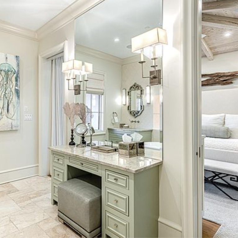 Luxurious bathroom with French country style and makeup vanity in Inlet Beach, FL. #bathroomdesign #makeupvanity