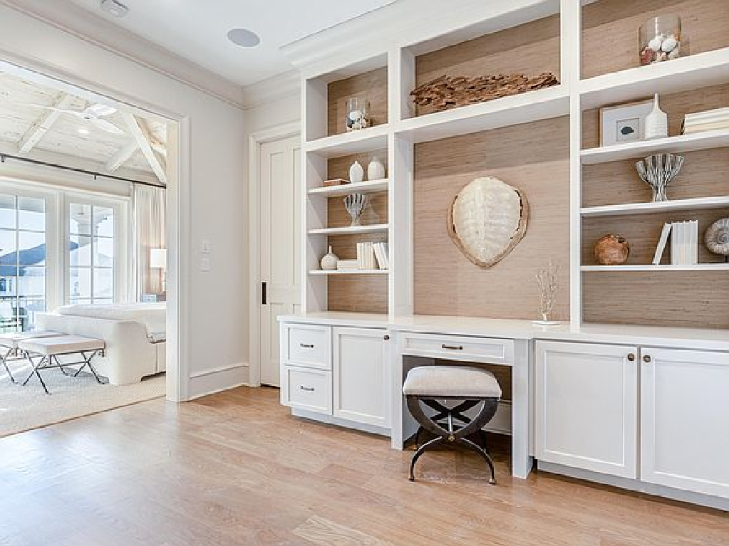 Traditional style built-ins in a sitting room adjacent to a tranquil coastal bedroom in Inlet Beach, FL. #interiordesign #bedroomdesign #builtins #sittingroom