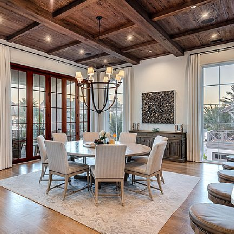 Luxurious coastal dining room with rustic wood ceiling in an Inlet Beach, FL home. #coastaldiningroom #woodceiling