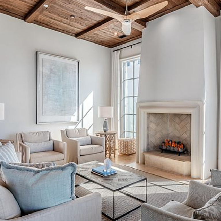 Sophisticated coastal living room with rustic wood ceiling in a luxury home in Inlet Beach, FL. #coastallivingroom #woodceiling