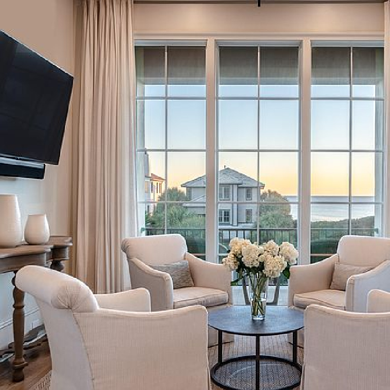 Cozy conversation area with white slope arm club chairs in a luxurious Inlet Beach, FL home.