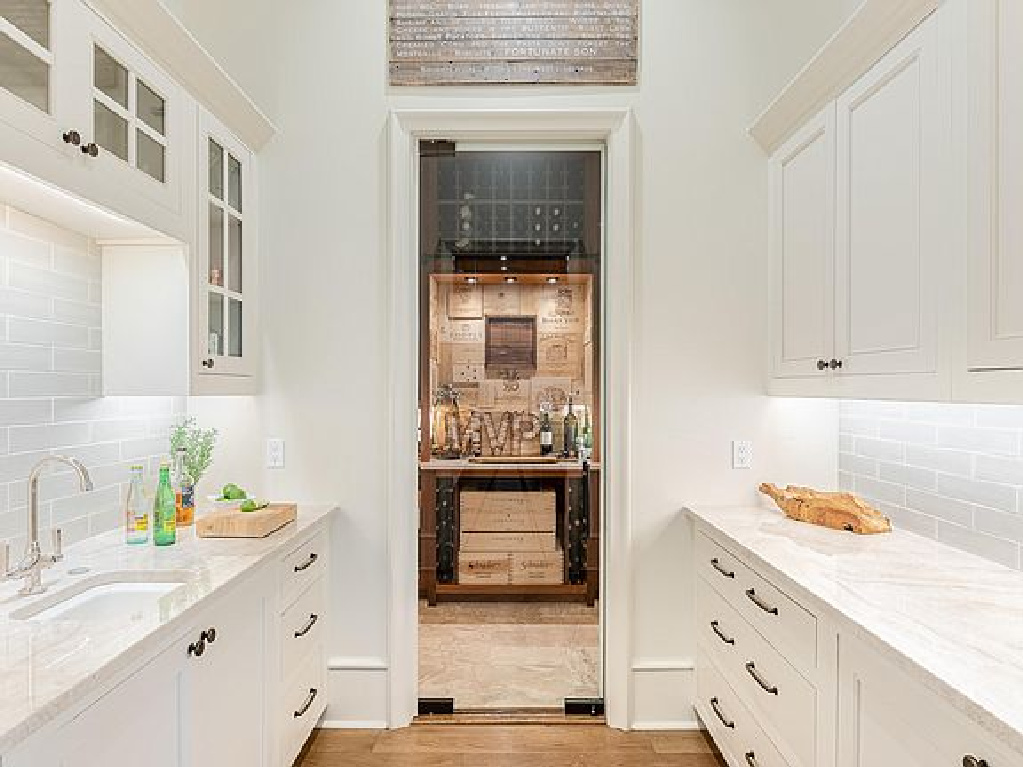 Charming white cabinetry in a butler pantry of a coastal home in Inlet Beach, FL. #butlerpantry #coastalstyle