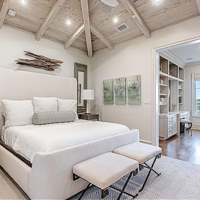 Relaxing coastal retreat bedroom with dramatic rustic wood ceiling in Inlet Beach, FL. #coastalbedroom #woodceiling