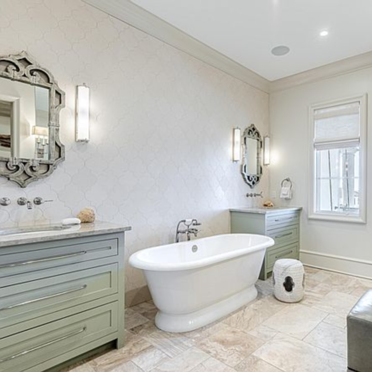 Luxurious French inspired bathroom with freestanding tub in a coastal Inlet Beach, FL home. #frenchcountry #bathroomdesign