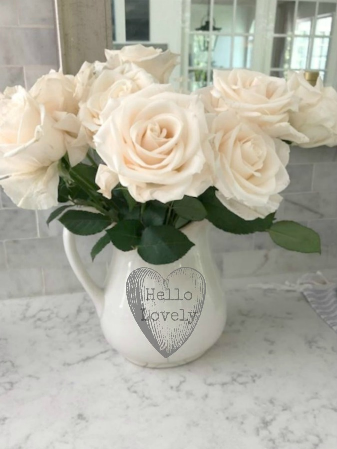 Ironstone pitcher of blush pink roses on kitchen counter (Viatera quartz - Minuet) - Hello Lovely Studio. #viatera #minuet
