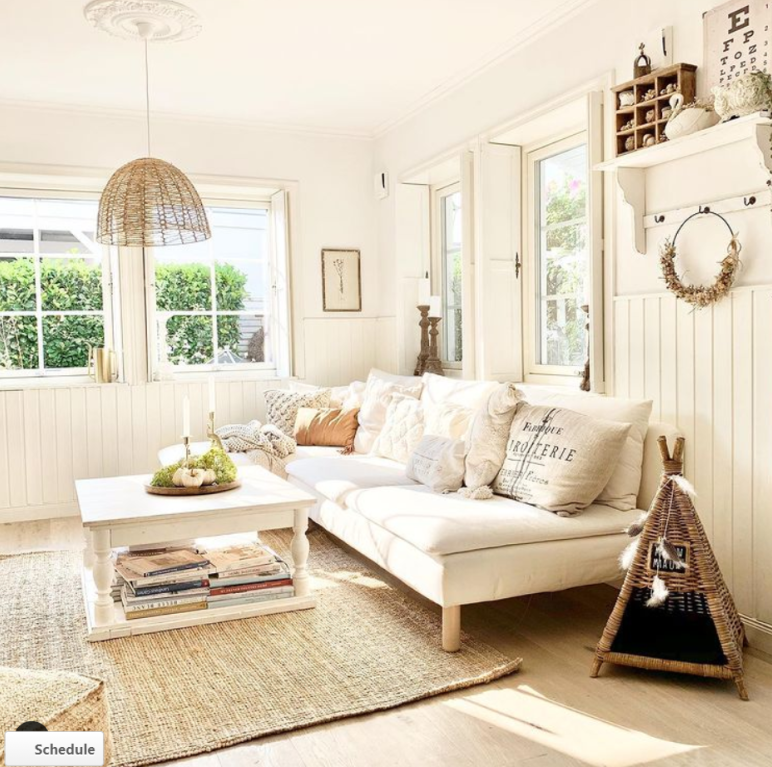 White on white Scandi living room with modern sofa, jute rug and neutrals - Villa Jenal.