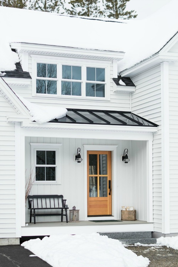 Charming white modern farmhouse custom home exterior in Maine - MGM Bulders. #modernfarmhouse #houseexteriors #whitehouses