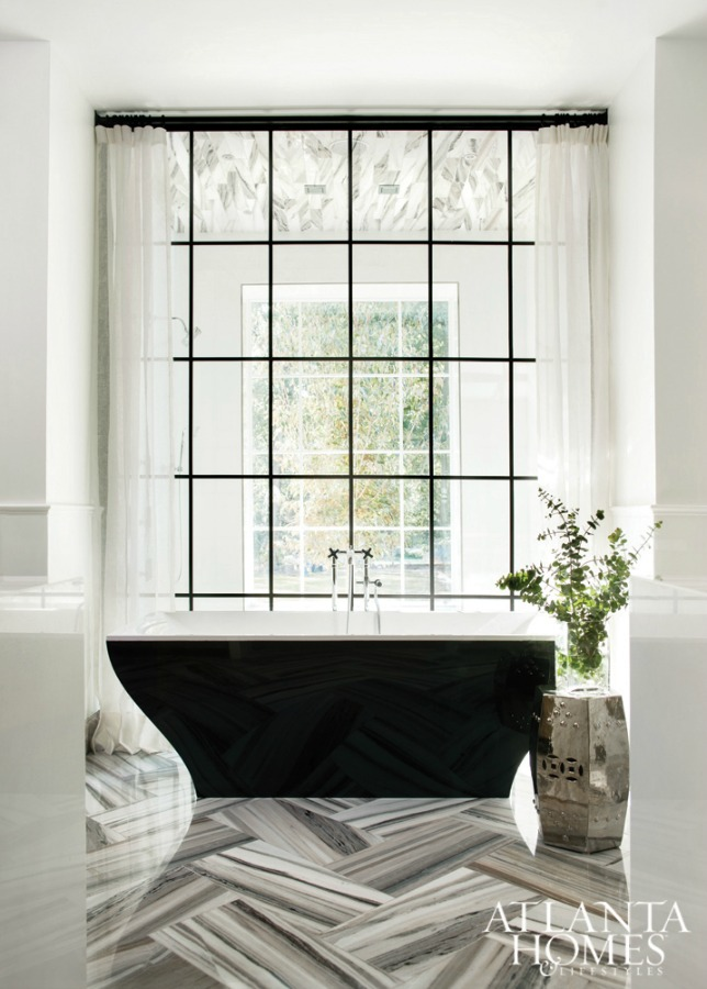 Luxurious black and white bathroom with soaring window and design by Sherry Hart. #bathroomdesign #luxuriousbathroom #blackandwhite #interiordesign