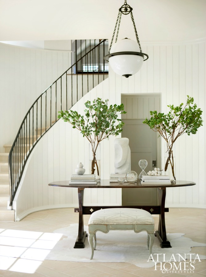 Magnificent entry and staircase in the home of architect Michael Ladisic - design by Sherry Hart. #entry #interiordesign #neutraldecor