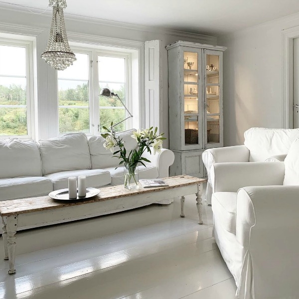 Ethereal, serene, and spare French Nordic white living room by Cathrine Aust. #frenchnordic #livingroom #scandinaviandecor #allwhitedecor #interiordesign