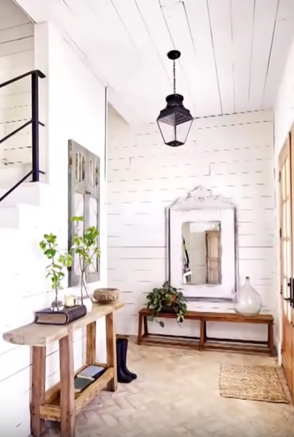 Chip and Joanna's Waco farmhouse entry with shiplap on walls, barn style lantern, and rustic decor. #fixerupper #joannagaines #farmhouse #entry #shiplap