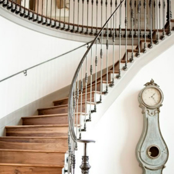 Magnificent French country staircase and antique Swedish Mora clock in a chateau in Utah by Decor de Provence.
