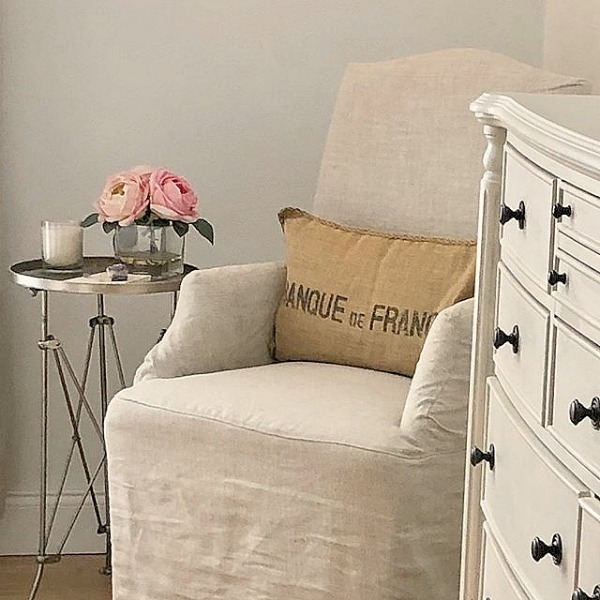 Hello Lovely Studio's Nordic French bedroom with Belgian linen accent chair and campaign style table. #nordicfrenchstyle #bedroomdecor #serenedecor #interiordesign #europeancountry