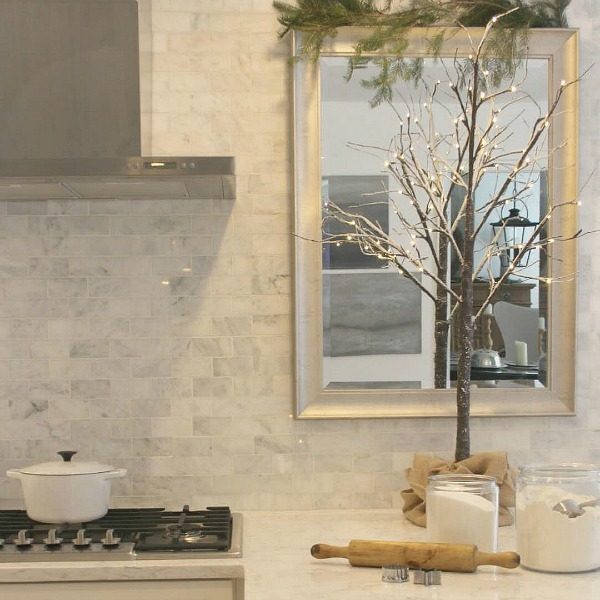 Polished marble subway tile backsplash and Viatera Minuet quartz counter in Hello Lovely Studio's French Nordic style white Shaker kitchen. #nordicfrench #kitchendesign #viateraminuet #marblesubwaytile