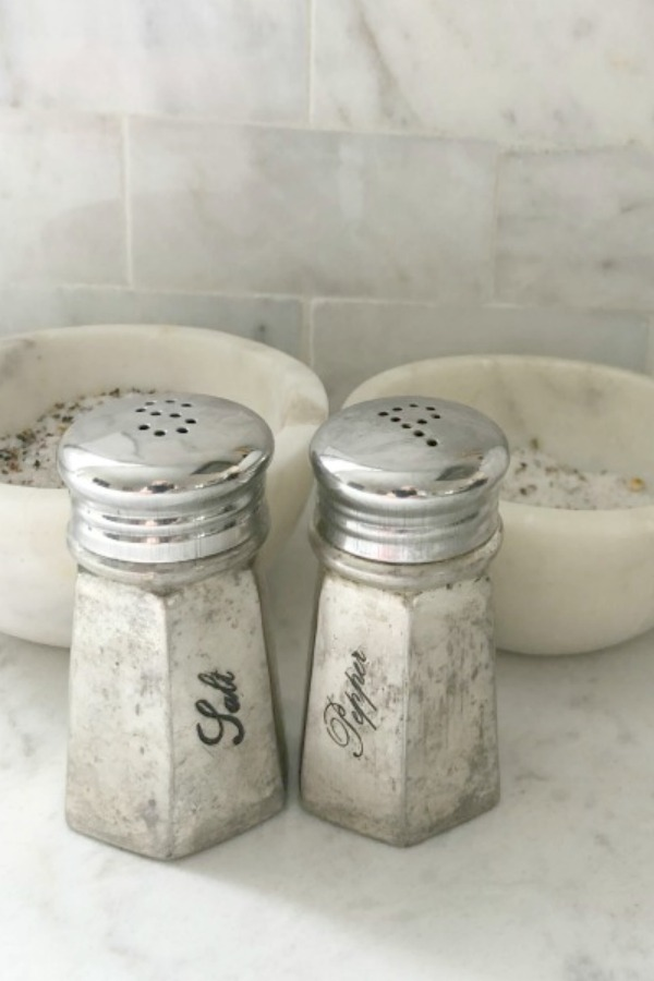 Antiqued silver salt and pepper shakers on my kitchen counter (Viatera Minuet quartz). #hellolovelystudio #antiquedsilver #kitchendecor #viateraquartz #minuet