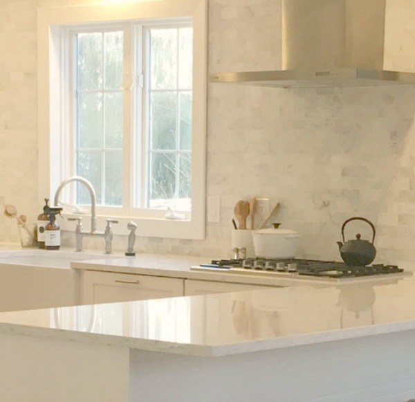 "My simple white Shaker kitchen with white oak floors, marble subway backsplash, Viatera quartz ""Minuet"" counters, and a window seat. #hellolovelystudio #whiteshakerkitchen #kitchendesign #kitchendecor #classickitchen #viateraquartz #minuet"