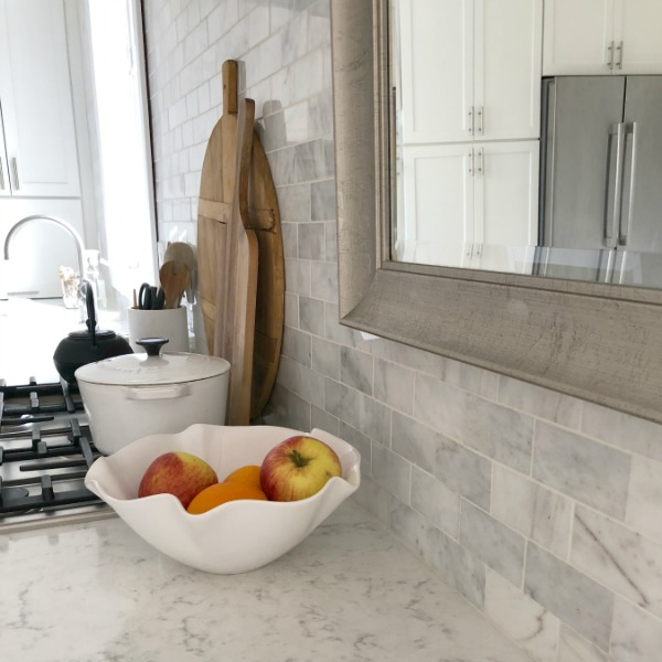 "My simple white Shaker kitchen with white oak floors, marble subway backsplash, Viatera quartz ""Minuet"" counters, and a window seat. #hellolovelystudio #whiteshakerkitchen #kitchendesign #kitchendecor #classickitchen #viateraquartz #minuet"