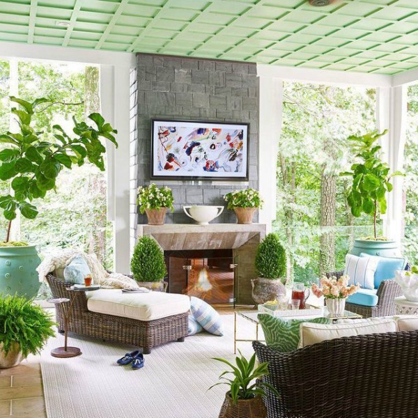 Green painted ceiling in an eclectic and colorful porch in the House Beautiful Whole Home - interior design by Sherry Hart.