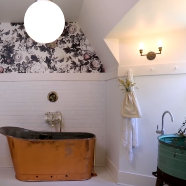 Ellie Cashman Summer Squall in Daylight White wallpaper in a white bathroom with vintage chic style by Leanne Ford. #bathroomdesign #vintagestyle #leanneford #copperbathtub #elliecashman