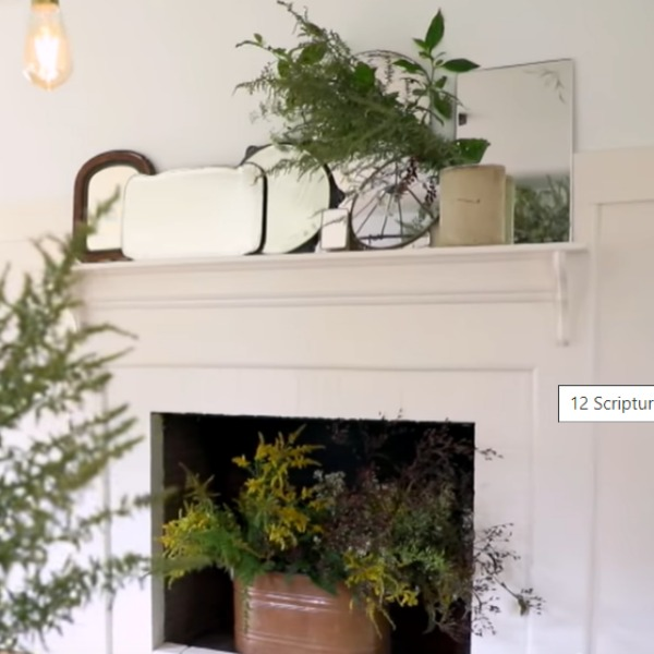 Organic style by Leanne Ford and rustic laid back luxe decor on a fireplace with a collection of vintage mirrors. Check out Leanne Ford's Paint Colors in the Sweetest Country Cottage! #fireplace #leanneford #farmhousestyle #vintagestyle #organic #slowliving